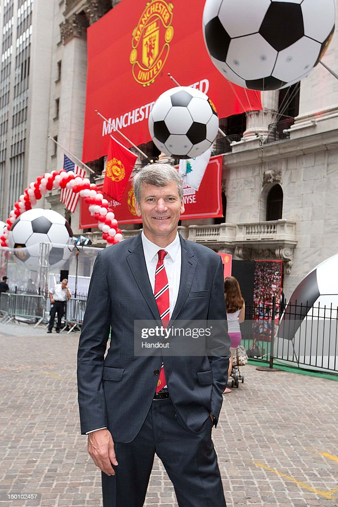 In this handout photo provided by the NYSE Euronext, Manchester United Executive David Gill arrives to ring the Opening Bell at the New York Stock Exchange on August 10, 2012 in New York City. Manchester United shares started trading at USD 14.05 at the opening of the New York Stock Exchange.
