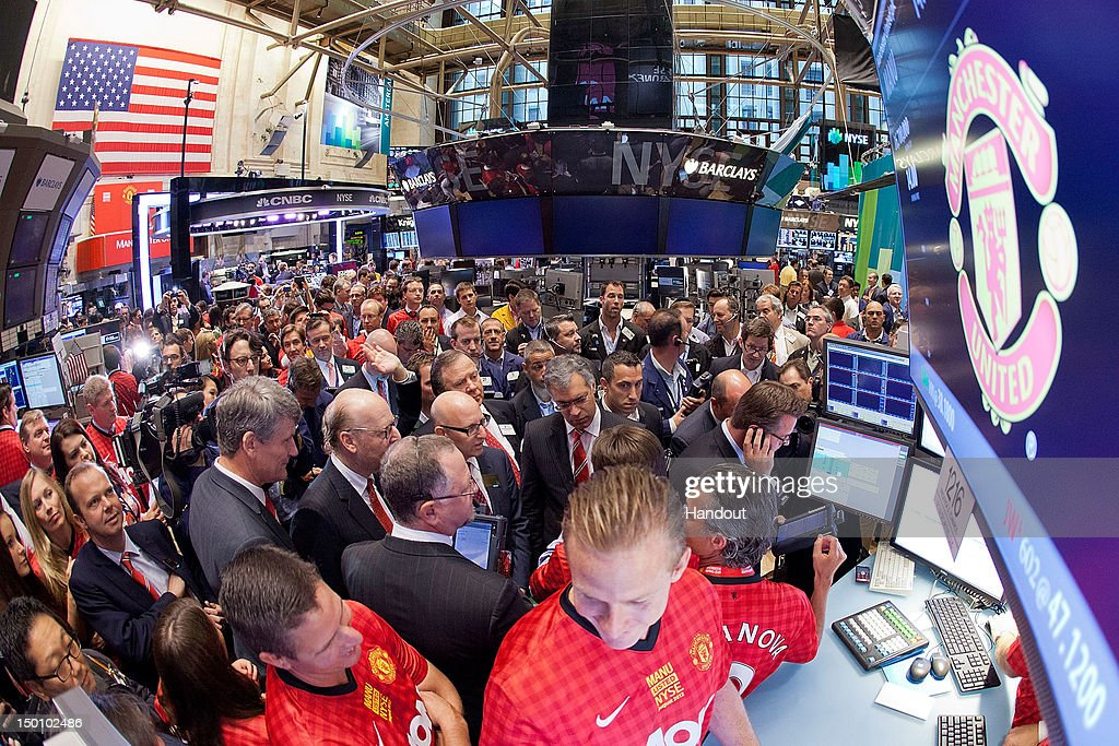 In this handout photo provided by the NYSE Euronext, Manchester United Executives David Gill, (L) Joel Glazer (C) and Avram Glazer (C,L) prepare to ring the Opening Bell at the New York Stock Exchange on August 10, 2012 in New York City. Manchester United shares started trading at USD 14.05 at the opening of the New York Stock Exchange.