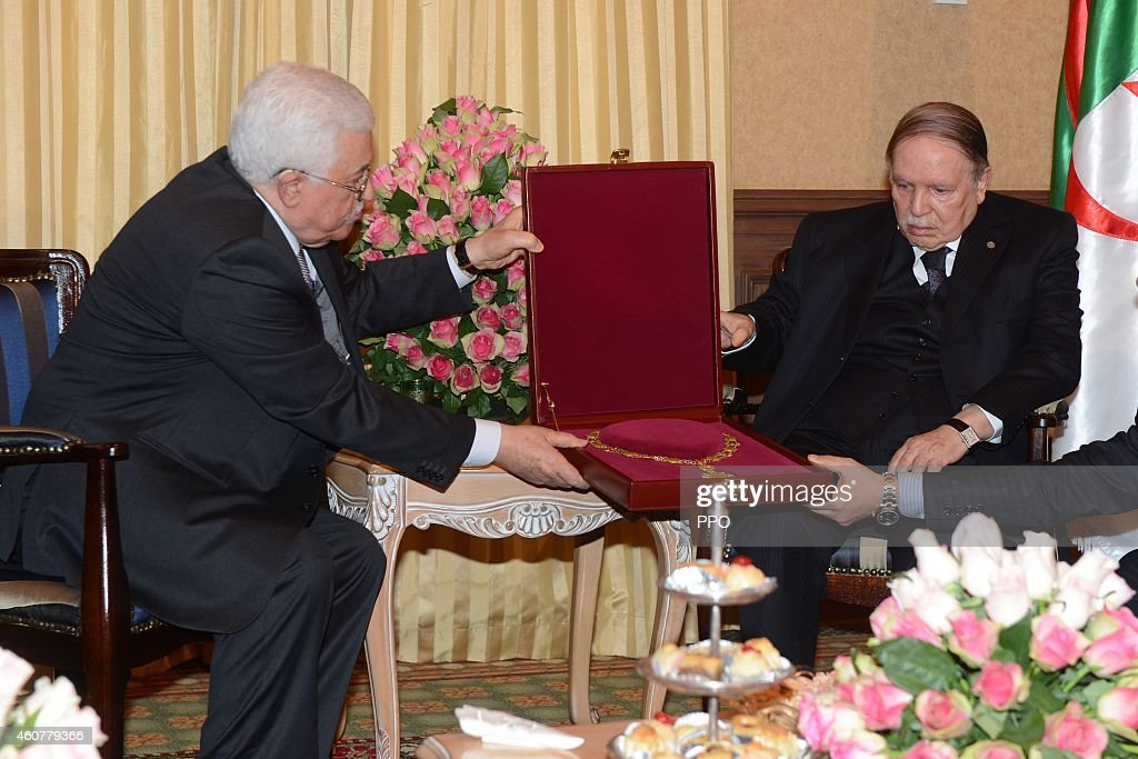 In this handout photo provided by the Palestinian Press Office (PPO), Palestinian President, Mahmoud Abbas (Abu Mazen) during a meeting with Algerian President, Abdelaziz Bouteflika (R) on December 22, 2014 in Algeria. President, Abbas is to hold talks with his Algerian counterpart Abdelaziz Bouteflika on the latest developments of the Palestinian cause.