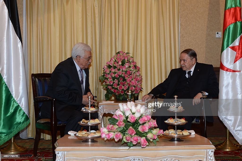 In this handout photo provided by the Palestinian Press Office (PPO), Palestinian President, Mahmoud Abbas (Abu Mazen) during a meeting with Algerian President, <a gi-track='captionPersonalityLinkClicked' href=/galleries/search?phrase=Abdelaziz+Bouteflika&family=editorial&specificpeople=176720 ng-click='$event.stopPropagation()'>Abdelaziz Bouteflika</a> (R) on December 22, 2014 in Algeria. President, Abbas is to hold talks with his Algerian counterpart <a gi-track='captionPersonalityLinkClicked' href=/galleries/search?phrase=Abdelaziz+Bouteflika&family=editorial&specificpeople=176720 ng-click='$event.stopPropagation()'>Abdelaziz Bouteflika</a> on the latest developments of the Palestinian cause.