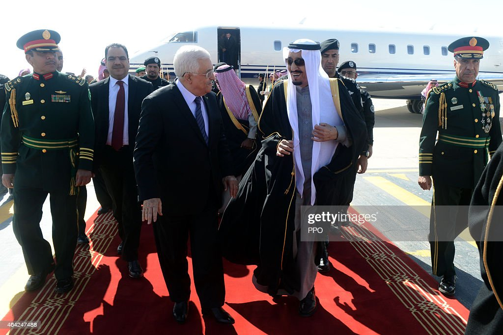 In this handout photo provided by the Palestinian Press Office (PPO), Palestinian President Mahmoud Abbas is received by King Salman bin Abdulaziz Al Saud of Saudi Arabia at King Khalid International Airport on February 23, 2015 in Riyadh, Saudi Arabia. Abbas is on an official visit to the Kingdom of Saudi Arabia.