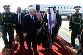 In this handout photo provided by the Palestinian Press Office Palestinian President Mahmoud Abbas is received by King Salman bin Abdulaziz Al Saud...