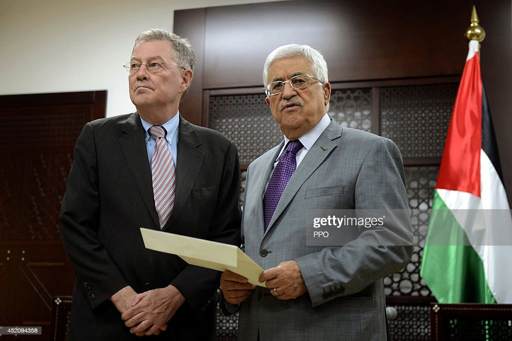 In this handout photo provided by the Palestinian Press Office (PPO), Palestinian President <a gi-track='captionPersonalityLinkClicked' href=/galleries/search?phrase=Mahmoud+Abbas&family=editorial&specificpeople=176534 ng-click='$event.stopPropagation()'>Mahmoud Abbas</a> (R) delivers to United Nations Special Coordinator for the Middle East Peace Process Robert Serry, a letter for the Secretary General of the UN July 13, 2014 in Ramallah, West Bank. The total number of Palestinians killed by Israeli airstrikes on the Gaza Strip since Monday has reached 166, according to a Palestinian Health Ministry official.