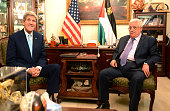 In this handout photo provided by the Palestinian Press Office Palestinian President Mahmoud Abbas meets with US Secretary of State John Kerry on...