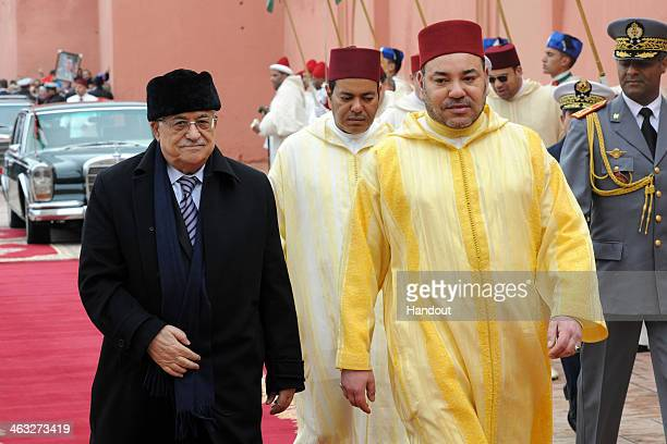 In this handout photo provided by the Palestinian Press Office Palestinian President Mahmoud Abbas meets with with King Mohammed VI of Morocco during...