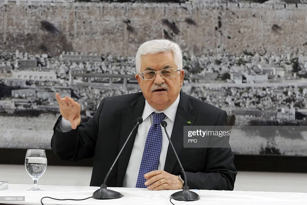 In this handout photo provided by the Palestinian Press Office (PPO), Palestinian President <a gi-track='captionPersonalityLinkClicked' href=/galleries/search?phrase=Mahmoud+Abbas&family=editorial&specificpeople=176534 ng-click='$event.stopPropagation()'>Mahmoud Abbas</a> speaks during a press meeting on April 22, 2014 in Ramallah, West Bank.