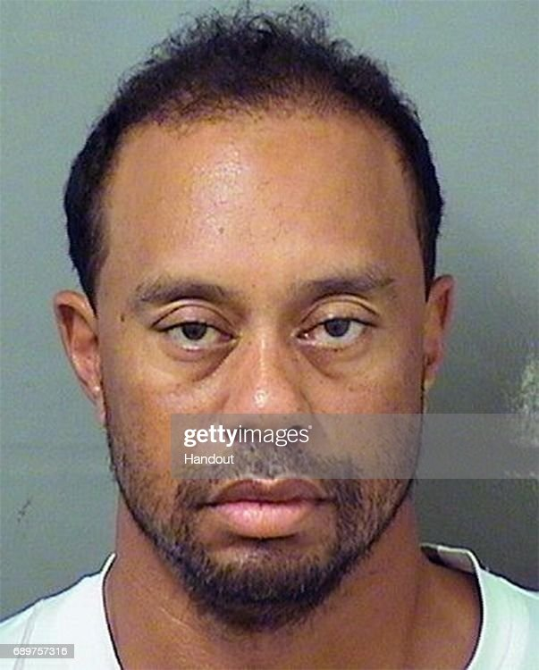 In this handout photo provided by The Palm Beach County Sheriff's Office, golfer Tiger Woods is seen in a police booking photo after his arrest on suspicion of driving under the influence (DUI) May 29, 2017 in Jupiter, Florida. Woods has been released on his own recognizance.