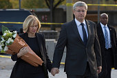 In this handout photo provided by the PMO Prime Minister Stephen Harper and his wife Laureen Harper arrive at the National War Memorial to lay...