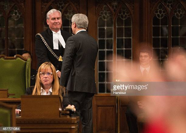 In this handout photo provided by the PMO Prime Minister Stephen Harper shakes hands with Kevin Vickers SergeantatArms following his remarks in the...