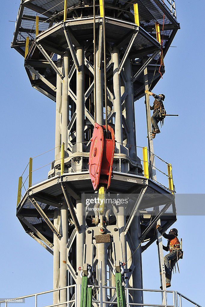 In this handout photo provided by the Port Authority of New York and New Jersey, the final section of spire is installed atop One World Trade Center May 10, 2013 in New York City. After more than 11 years of construction and planning, One World Trade Center reached its final height this morning of 1,776 feet. When it opens for business in 2014, One World Trade center will be home to companies including Conde Nast and Vantone Holdings China Center. One World Trade Center is built on the site where the September 11, 2001 attacks toppled the original World Trade Center towers.