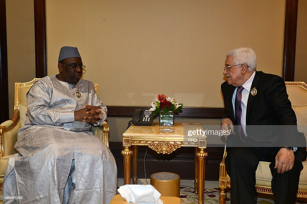 In this handout photo provided by the PPO, Palestinian President Mahmoud Abbas (R) meets with Senegalese President Macky Sall during the Arab-African Summit November 19, 2013 in Kuwait City, Kuwait. Leaders gathered for the two-day summit to discuss economic ties between Africa and the Gulf.