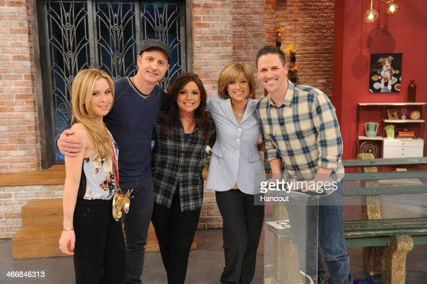 In this handout photo provided by The Rachael Ray Show Rachael Ray and Tara Lipinski Brian Boitano Dorothy Hamill and Chad Hedrick celebrate the...