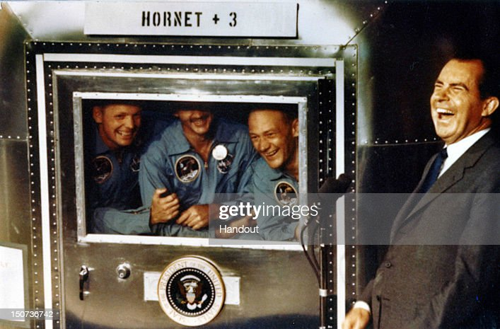 In this handout photo provided by the <a gi-track='captionPersonalityLinkClicked' href=/galleries/search?phrase=Richard+Nixon&family=editorial&specificpeople=92456 ng-click='$event.stopPropagation()'>Richard Nixon</a> Foundation, Apollo XI astronauts <a gi-track='captionPersonalityLinkClicked' href=/galleries/search?phrase=Neil+Armstrong&family=editorial&specificpeople=92197 ng-click='$event.stopPropagation()'>Neil Armstrong</a>, Michael Collins and <a gi-track='captionPersonalityLinkClicked' href=/galleries/search?phrase=Buzz+Aldrin&family=editorial&specificpeople=90480 ng-click='$event.stopPropagation()'>Buzz Aldrin</a> laugh with President <a gi-track='captionPersonalityLinkClicked' href=/galleries/search?phrase=Richard+Nixon&family=editorial&specificpeople=92456 ng-click='$event.stopPropagation()'>Richard Nixon</a> aboard the USS Hornet, July 24, 1969. The President was on hand to greet the astronauts after their splashdown in the Pacific.