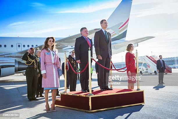 In this handout photo provided by the Royal Jordanian Household King Felipe of Spain and Queen Letizia of Spain receive King Abdullah of Jordan and...