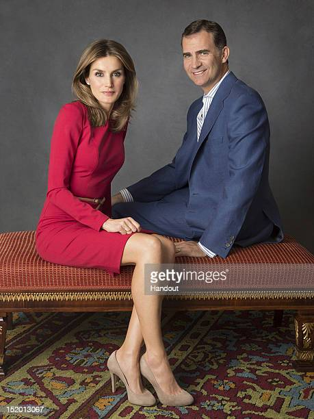 In this handout photo provided by the Royal Press Department Princess Letizia of Spain and Prince Felipe of Spain pose at Zarzuela Palace on...