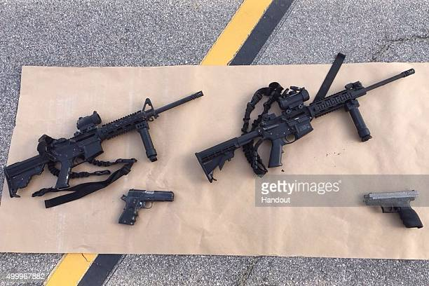 In this handout photo provided by the San Bernardino County Sherrif's Department four guns are seen near the site of a shootout between police and...