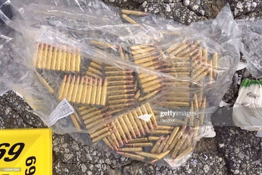 In this handout photo provided by the San Bernardino County Sherrif's Department a bag of ammunition is seen near the site of a shootout between...