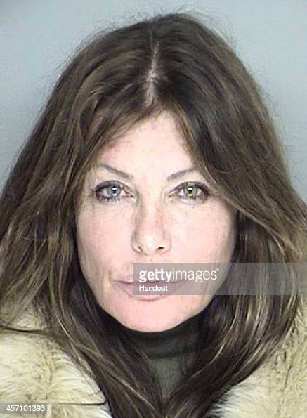 In this handout photo provided by the Santa Barbara Sheriffs Office actress Kelly LeBrock is seen in a police booking photo after her arrest for...