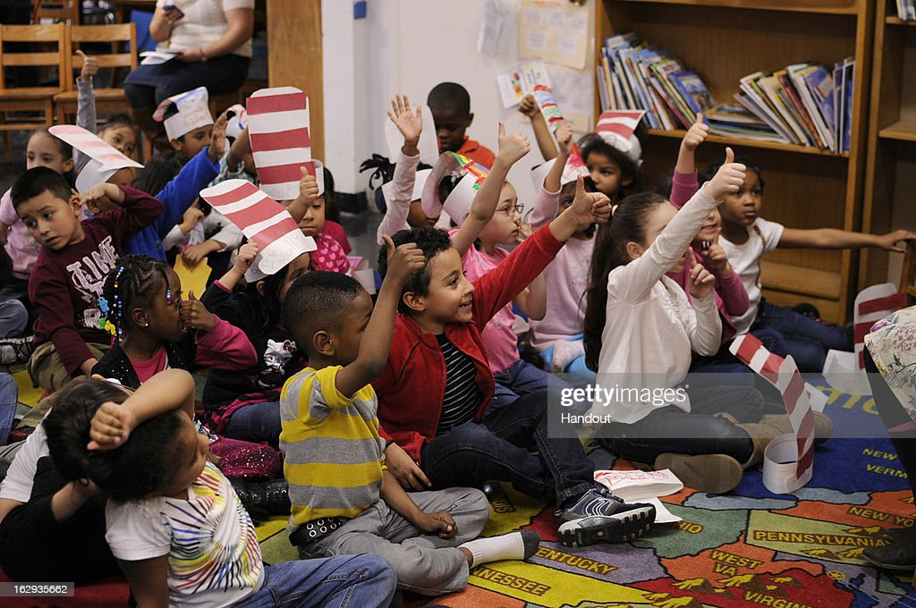 In this handout photo provided by the Screen Actors Guild Foundation, Fatima Ptacek (not pictured), voice of 'Dora the Explorer' and star of 2013 Oscar winning short film 'Curfew,' reads to a kindergarten class at PS 111 in Manhattan with the Screen Actors Guild Foundation BookPALS and Brooke Jackman Foundation on Read Across America Day, March 1, 2013 in New York City.