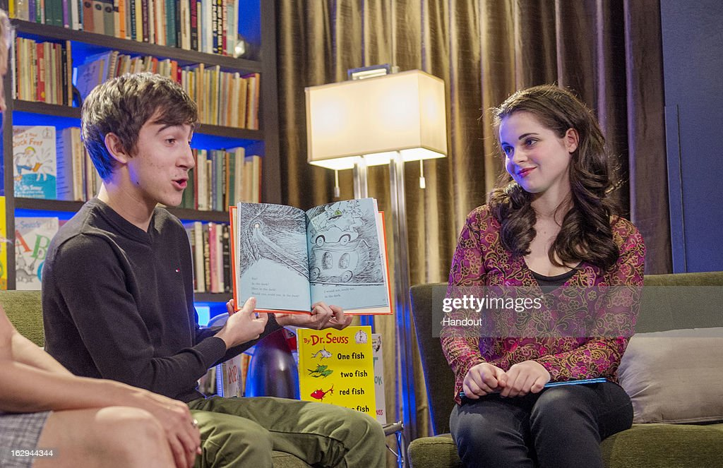 In this handout photo provided by the Screen Actors Guild Foundation, Vanessa Marano ('Switched and Birth') and Vincent Martella ('Phineas and Ferb') read Dr. Seuss for classrooms across the country over the SAG Foundation's livestream during Read Across America Day on March 1, 2013 in Los Angeles, California.