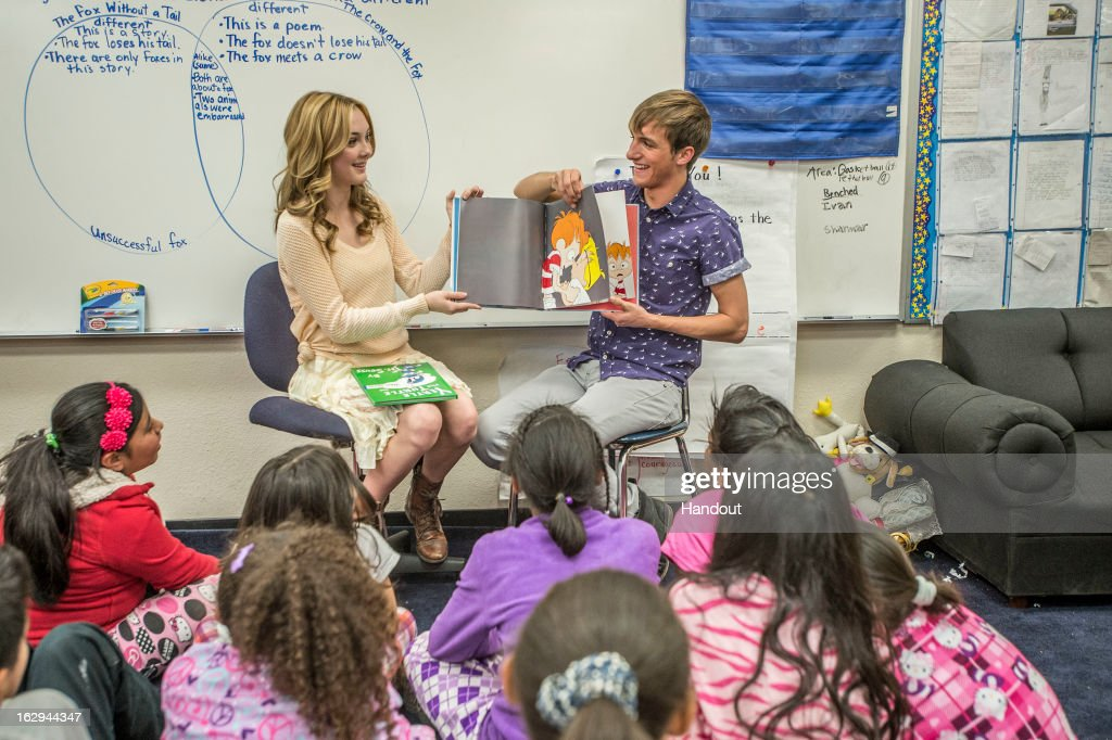 In this handout photo provided by the Screen Actors Guild Foundation, Lucas Cruikshank and Victory Van Tuyl ('Marvin Marvin') read to fourth and fifth graders at Crescent Heights Elementary with the Screen Actors Guild Foundation BookPALS during Read Across America Day on March 1, 2013 in Los Angeles, California.