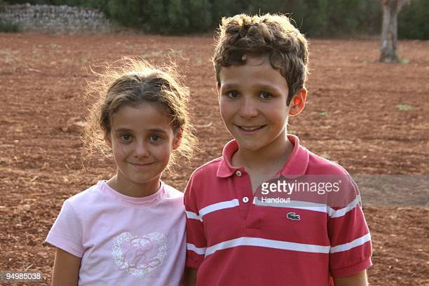 In this handout photo provided by the Spanish Royal House Princess Victoria Federica and Prince Felipe Juan Froilan de Todas of Spain pose for the...