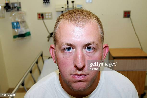 In this handout photo provided by the St Louis County Prosecutor's Office Ferguson police officer Darren Wilson poses in an evidence photo at the...