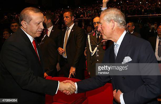 In this handout photo provided by the Turkish President's Office HRH Prince of Wales is welcomed by HE Turkish President Recep Tayyip Erdogan at a...