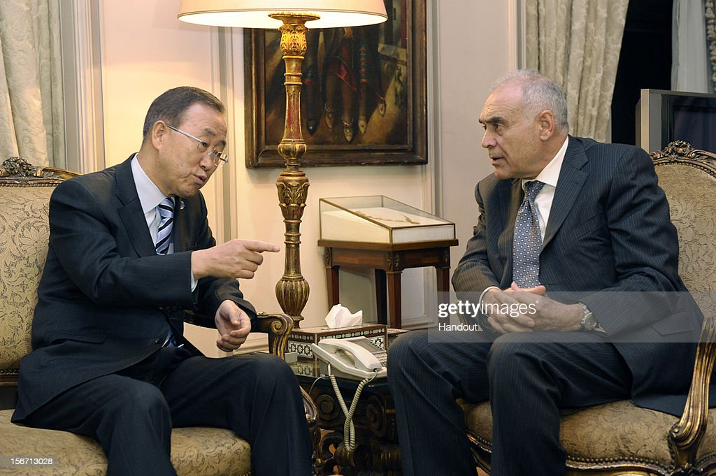 In this handout photo provided by the United Nations, U.N. Secretary-General Ban Ki-moon (L) meets with Egyptian Foreign Minister Mohammed Kamel Amr November 19, 2012 in Cairo, Egypt. Ban arrived in Cairo to support Morsi's efforts to mediate a truce. He is scheduled to visit Jerusalem and the West Bank city of Ramallah this week for talks with Netanyahu and Palestinian President Mahmoud Abbas on the crisis in Gaza. (Photo by Evan Schneider/UN via Getty Images