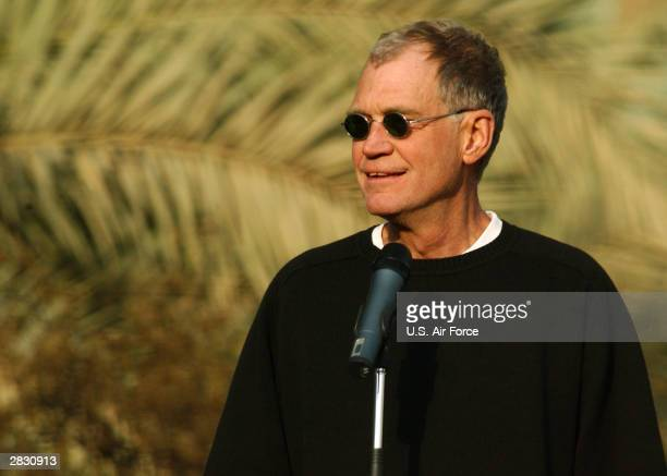 In this handout photo provided by the US Air Force 'Late Show' television host David Letterman entertains soldiers at the Coalition Provisional...