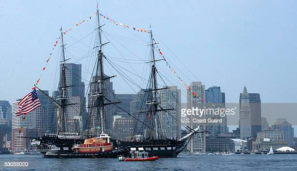 In this handout photo provided by the US Coast Guard multiple Coast Guard resources escort the USS Constitution Boston's beloved 'Old Iron Sides'...