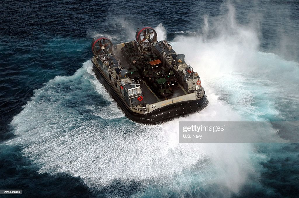 In this handout photo provided by the US Navy a Landing Craft Air Cushioned assigned to Assault Craft Unit Five embarked aboard the amphibious...