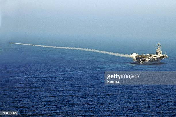 In this handout photo provided by the US Navy a RIM7P NATO Sea Sparrow Missile launches from Nimitzclass aircraft carrier USS Abraham Lincoln during...