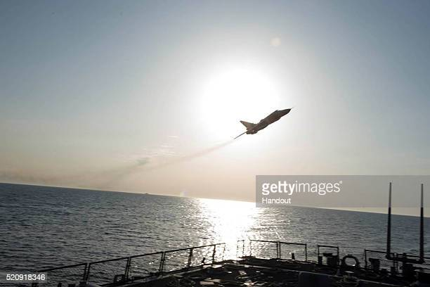 In this handout photo provided by the US Navy A Russian Sukhoi Su24 attack aircraft makes a low altitude pass by USS Donald Cook on April 12 2016 in...