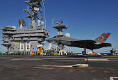 In this handout photo provided by the US Navy an F35C Lightening II carrier variant Joint Strike Fighter conducts it's first arrested landing aboard...