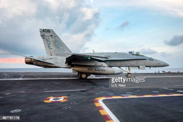 In this handout photo provided by the US Navy an F/A18C Hornet from the Strike Fighter Squadron 'Blue Blasters' launches from the aircraft carrier...