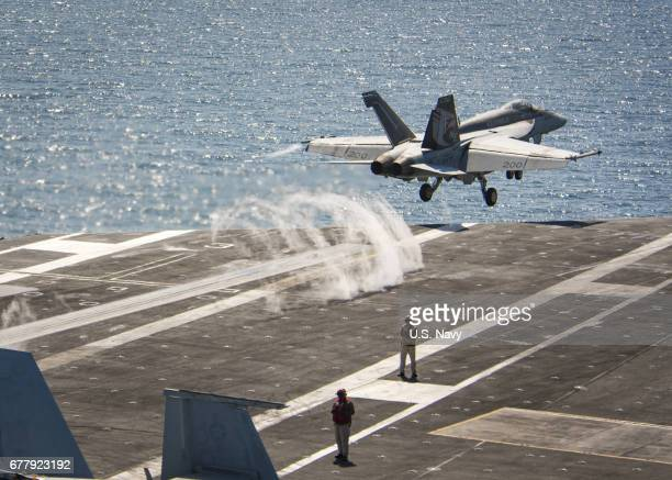 In this handout photo provided by the US Navy An F/A18E Super Hornet from the Kestrels of Strike Fighter Squadron 137 launches Tuesday May 2 2017...