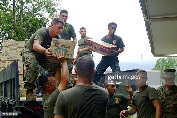 In this handout photo provided by the US Navy Marines assigned to the 31st Marine Service Support Group work together with Philippine Marines loading...