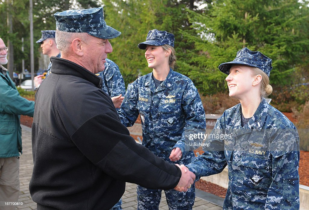 In this handout photo provided by the U.S. Navy, Master Chief Rusty Staub, assigned to Submarine Group 9 Command, congratulates Lt. j.g. Amber Cowan, assigned to the Blue crew of the ballistic missile submarine USS Maine (SSBN 741), for earning her submarine warfare officer device on December 5, 2012 in Bangor, Washington. Cowan is one of three Sailors to become the first female unrestricted line officers to qualify in submarines.