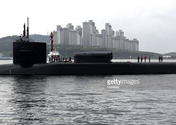 In this handout photo provided by the US Navy the guidedmissile submarine USS Michigan arrives on April 25 2017 in Busan South Korea The USS Michigan...