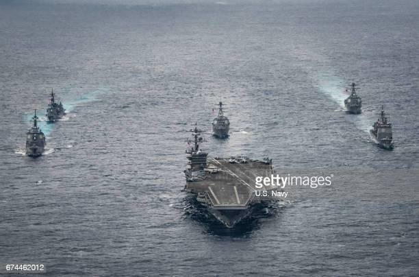 In this handout photo provided by the US Navy the Nimitzclass aircraft carrier USS Carl Vinson leads the Japan Maritime SelfDefense Force destroyers...