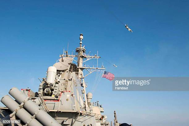 In this handout photo provided by the US Navy Two Russian Sukhoi Su24 attack aircraft fly over the USS Donald Cook on April 12 2016 in the Baltic Sea...