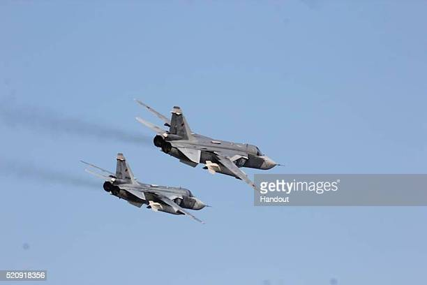 In this handout photo provided by the US Navy Two Russian Sukhoi Su24 attack aircraft fly over USS Donald Cook on April 12 2016 in the Baltic Sea...