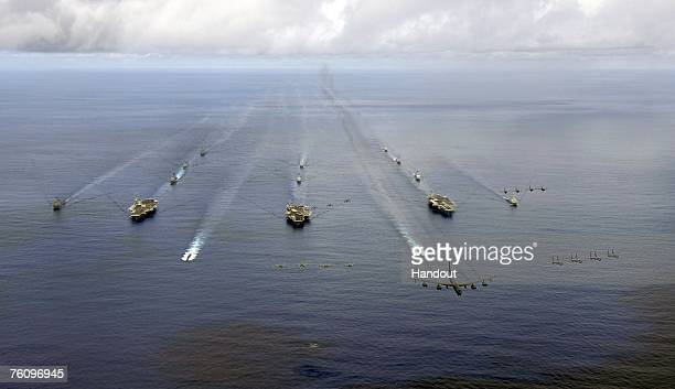 In this handout photo provided by the US Navy USS Nimitz USS Kitty Hawk and USS John C Stennis Carrier Strike Groups transit in formation during a...