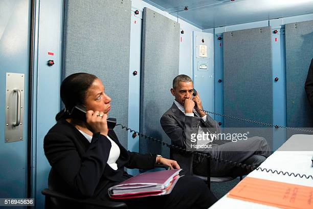 In this handout photo provided by the White House President Barack Obama and National Security Advisor Susan Rice talk on the phone with Homeland...