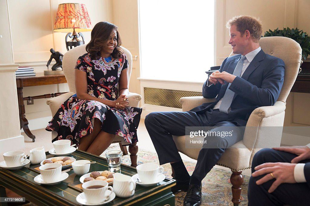 In this handout photo provided by The White House, US First Lady Michelle Obama meets Prince Harry at Kensington Palace on June 16, 2015 in London, England. The US First Lady is travelling with her daughters, Malia and Sasha and her mother, Mrs. Marian Robinson, to continue a global tour promoting her 'Let Girls Learn Initiative'. The event at the school was to discuss how the UK and USA are working together to expand girl's education around the world.