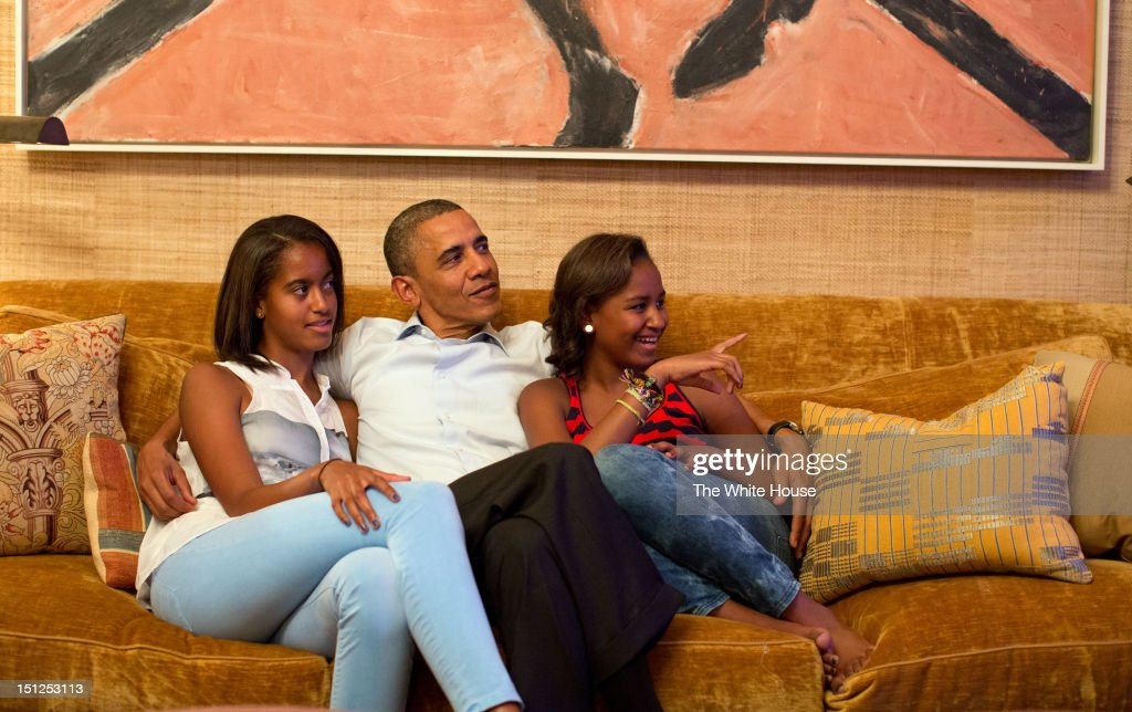 In this handout photo provided by The White House, U.S. President <a gi-track='captionPersonalityLinkClicked' href=/galleries/search?phrase=Barack+Obama&family=editorial&specificpeople=203260 ng-click='$event.stopPropagation()'>Barack Obama</a> and his daughters, Malia (L) and Sasha, watch on television as first lady Michelle Obama takes the stage to deliver her speech at the Democratic National Convention on September 4, 2012 in the Treaty Room of the White House in Washington, DC. The DNC that will run through September 7, will nominate U.S. President <a gi-track='captionPersonalityLinkClicked' href=/galleries/search?phrase=Barack+Obama&family=editorial&specificpeople=203260 ng-click='$event.stopPropagation()'>Barack Obama</a> as the Democratic presidential candidate.