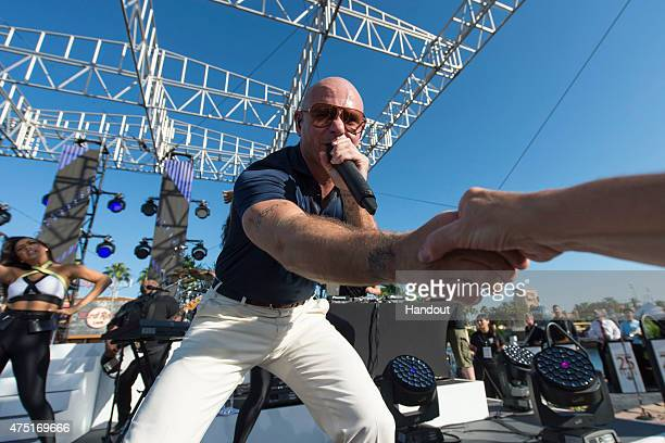 In this handout photo provided by Universal Orlando global music superstar Pitbull performed live at Universal Orlando Resort on Americas favorite...