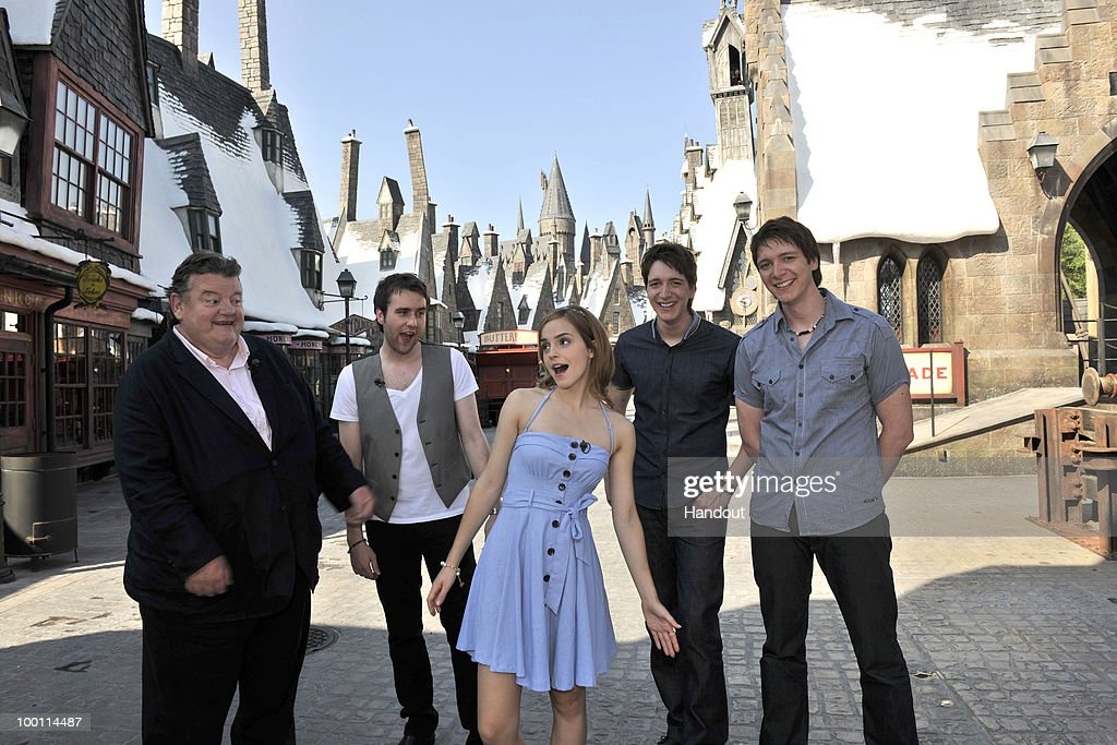 In this handout photo provided by Universal Orlando Harry Potter film stars Robbie Coltrane Matthew Lewis Emma Watson Oliver Phelps and James Phelps...