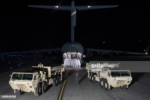 In this handout photo provided by US Forces Korea trucks are seen carrying parts required to set up the Terminal High Altitude Area Defense missile...